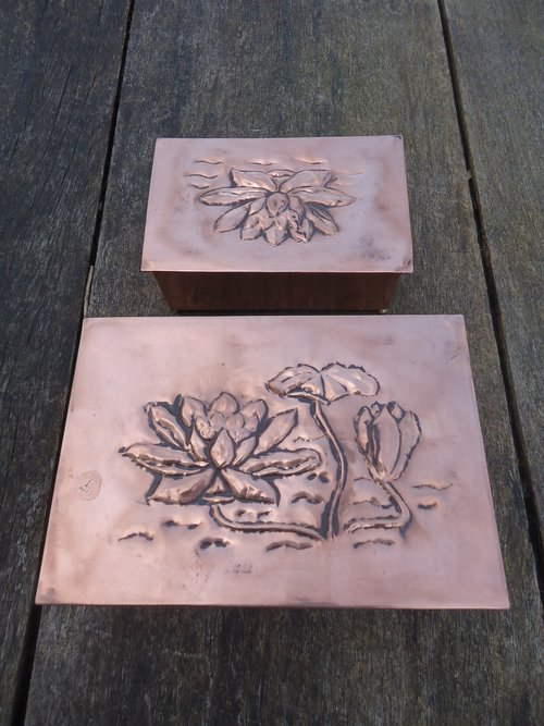 Pair of Arts & Crafts copper caskets