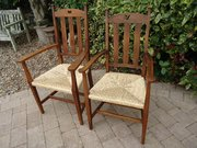 Pair of Arts & Crafts oak armchairs for Liberty