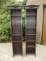 Pair of tall Arts & Crafts oak bookcases