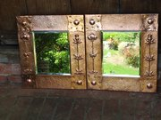 Rare pair of Newlyn School copper mirrors