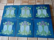 Set of Six Arts & Crafts tube lined floral tiles
