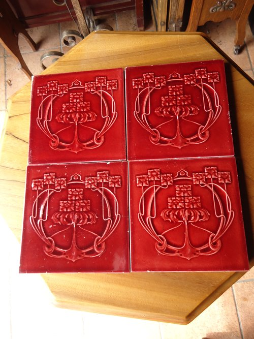 Set of four Arts & Crafts maroon tiles