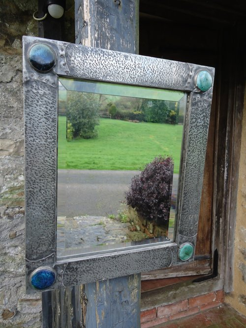 Small Arts & Crafts pewter mirror with cabochons