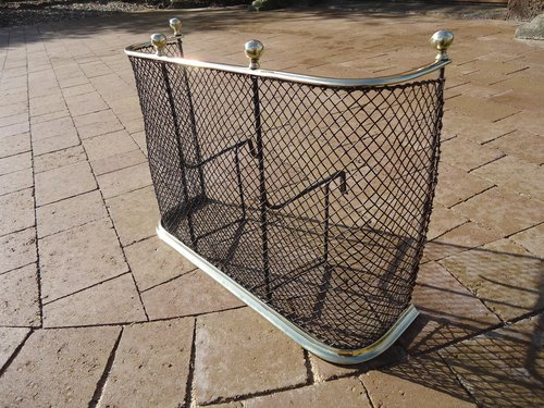 Small Victorian brass and wire fire guard