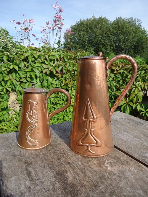 Two decorative Arts & Crafts jugs Pool of Hayle