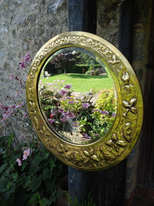 Unusual Arts & Crafts brass mirror