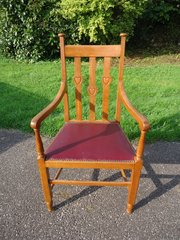 Arts & Crafts armchair with raised hearts
