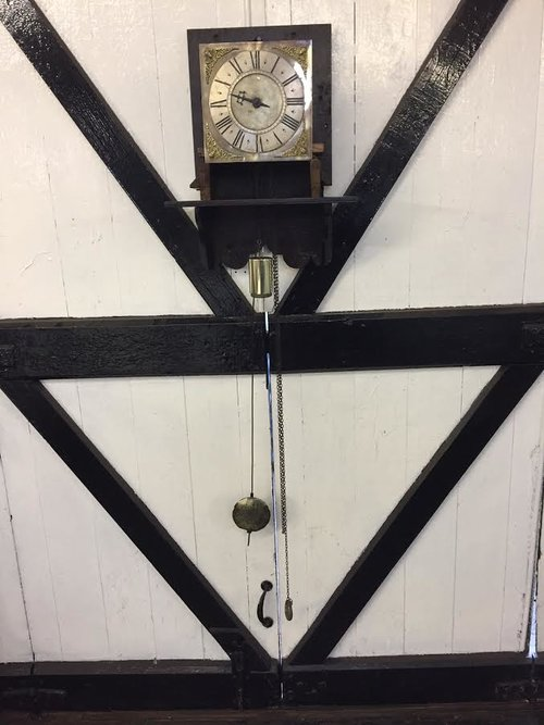 Hooded 8 day wall clock by John Dumville. c1730.