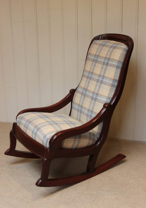 Victorian mahogany framed small proportioned upholstered rocking chair