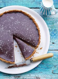 Rich chocolate tart with salt flakes