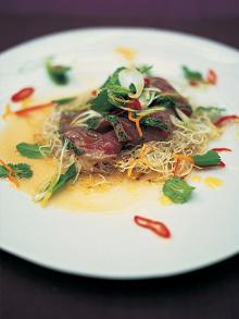 Citrus-seared tuna with crispy noodles, herbs and chilli
