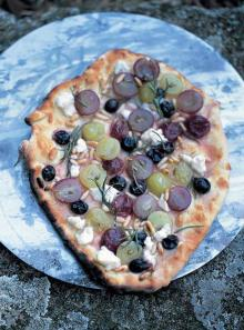 Green and red grapes, rosemary, pine nuts and ricotta pizza topping