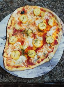 Potatoes, mozzarella, rosemary, thyme and tomato pizza topping