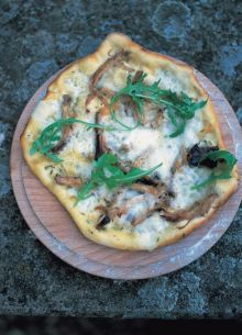 Slow-roasted shredded pork with thyme, Taleggio and lemon-dressed rocket pizza dressing