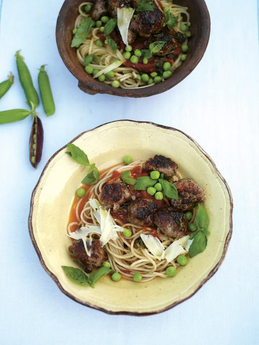 sausage meatballs with tomato, basil sauce, spaghetti and peas