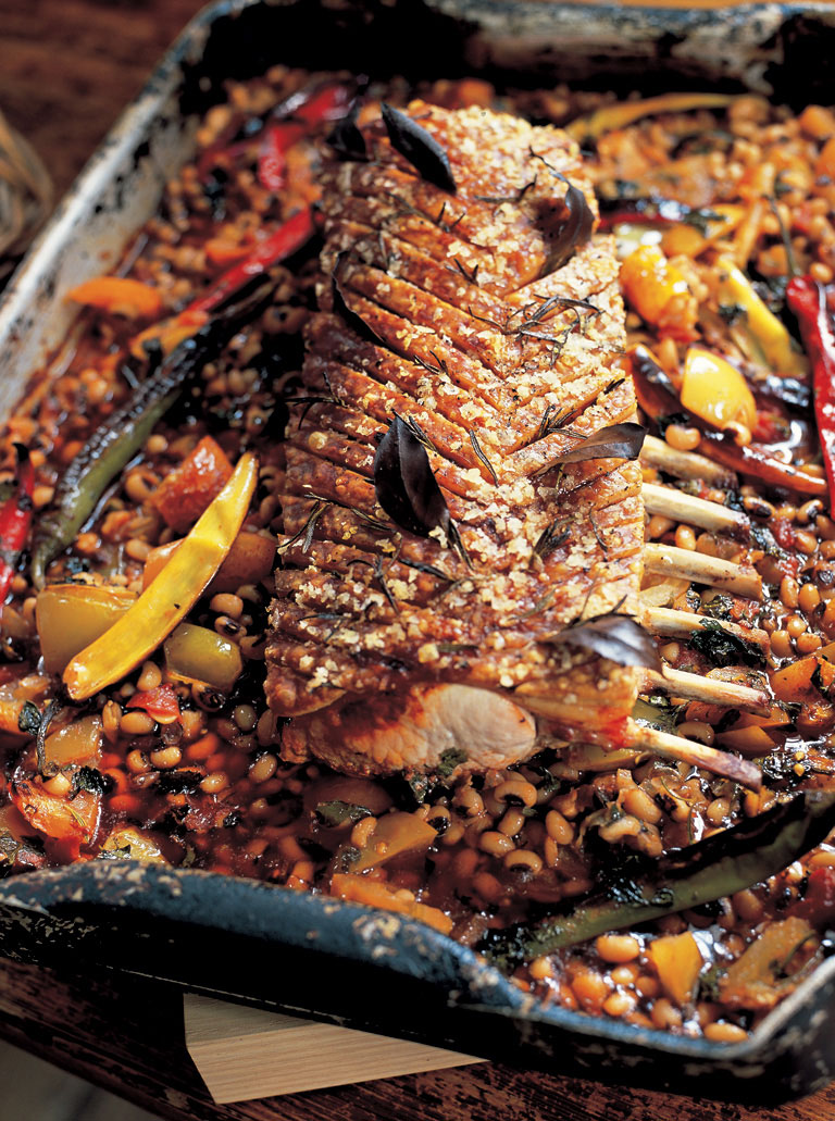 Slow-roasted spiced pork loin with black-eyed beans & tomatoes