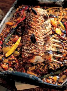 Slow-roasted spiced pork loin with black-eyed beans and tomatoes