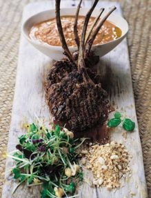 Barbecued lamb lollipops with spiked hummous & nuts