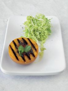 Warm grilled peach and frisée salad with goat's cheese dressing