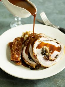 Gorgeous dinner of porchetta stuffed with wild mushrooms, celeriac mash and gravy