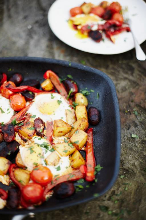 Fried eggs with roasted potato, peppers and chorizo