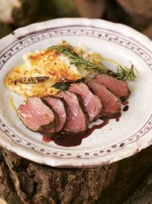 Pan-roasted venison with creamy baked potato & celeriac