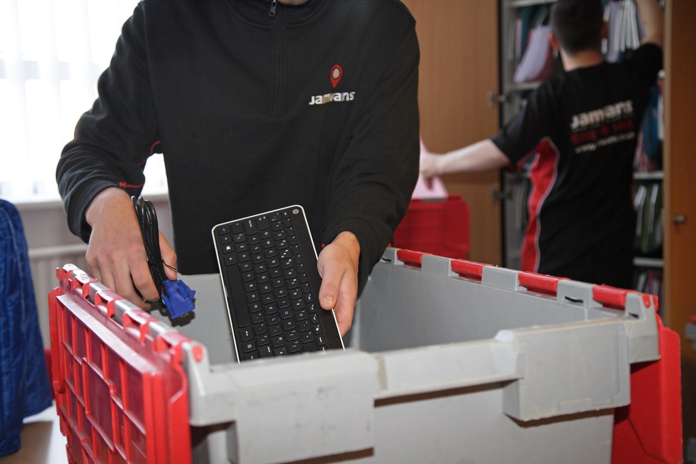 Man holding keyboard