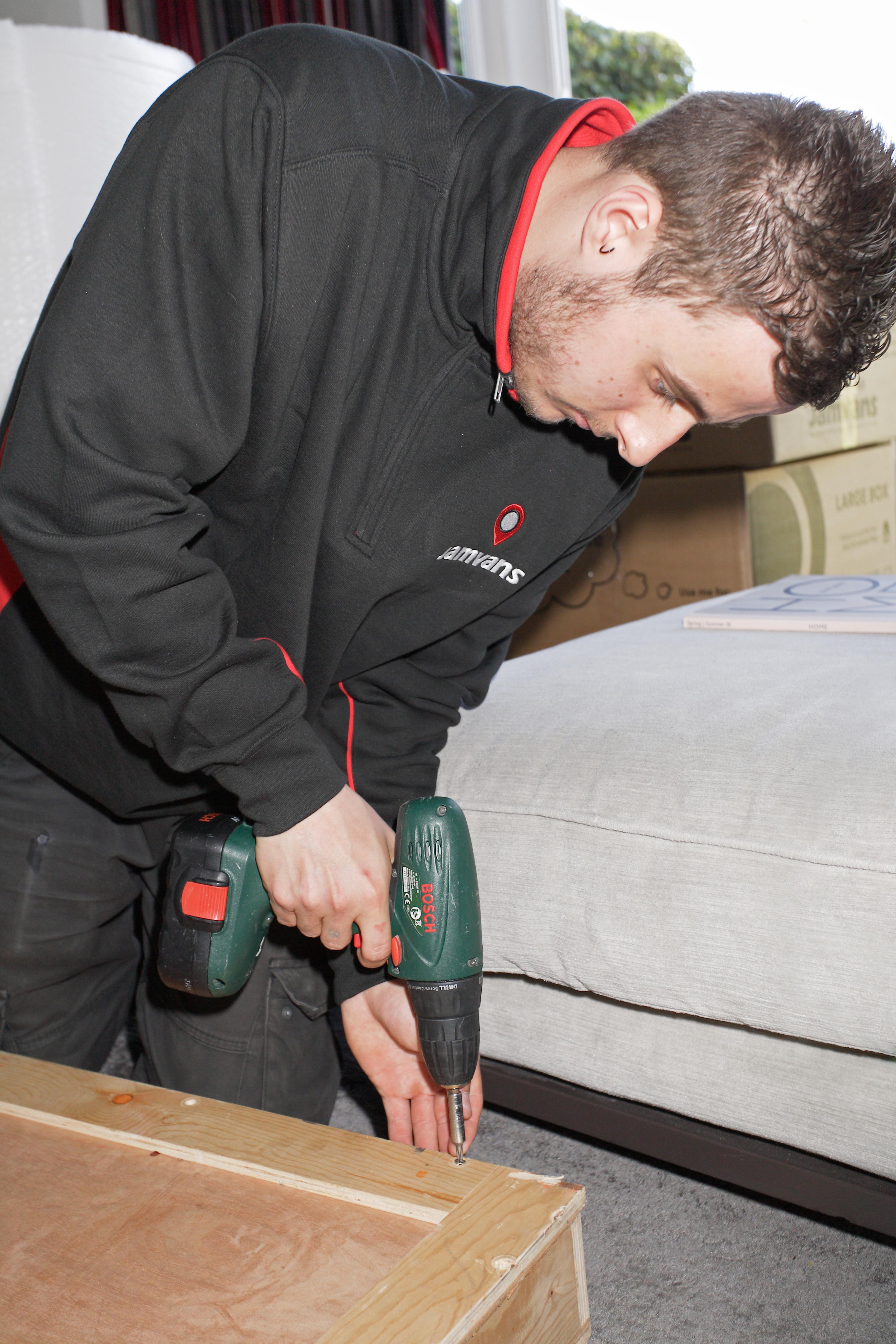 Man drilling furniture