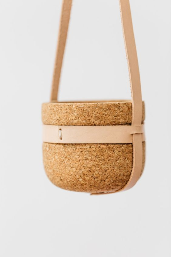Leather strap hanging cork planter by Melanie Abrantes