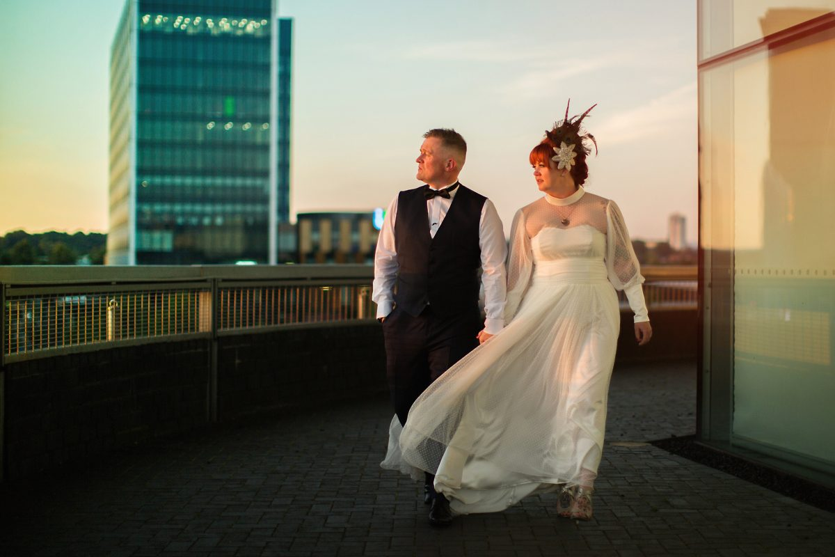 bride and groom looking over salford quays landscape