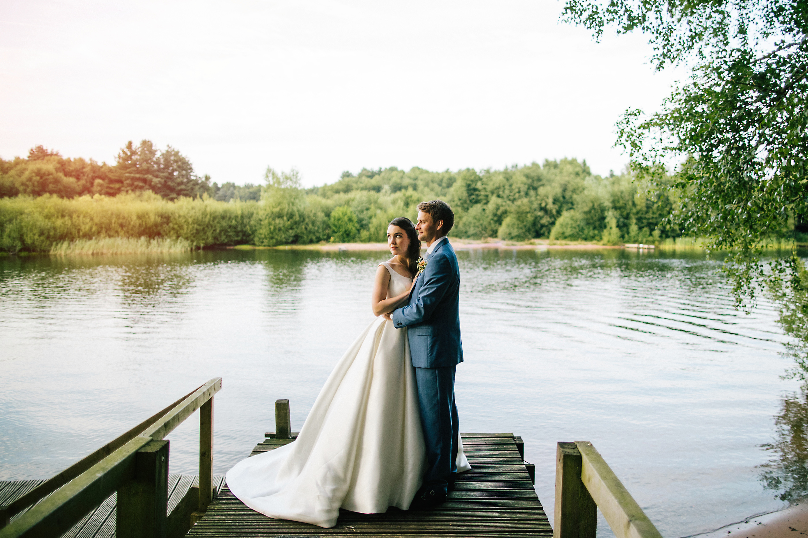 bride and groom at nunsmere lake jetty