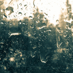 Rain droplets over glass