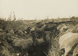 Lewis gunner on the firing step of a trench, 1916 (c)