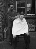 A trooper receives a haircut, 1944 (c)