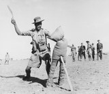 A Gurkha soldier demonstrates how to use the kukri fighting knife, November 1944