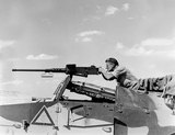 Soldier firing a .50 calibre machine-gun, 1942 (c)