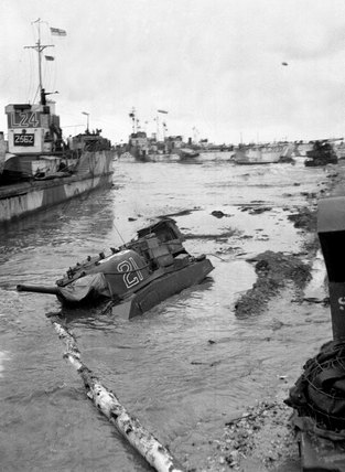 Assault craft and a half submerged Sherman tank, Normandy, June 1944