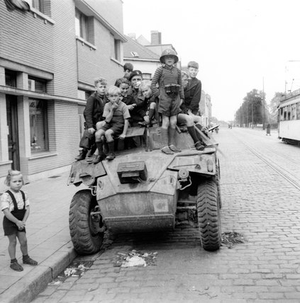 French children on Humber Scout Car, 1944