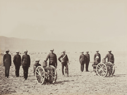A group of soldiers with two Gatling guns, 1879