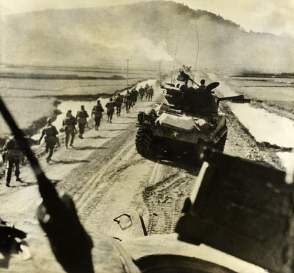 Infantry marching with tanks, Korea, 1950-1951