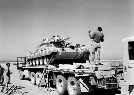 A Cruiser tank moving from one transporter to another, North Africa, 1943.<BR/>