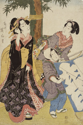 Two women and a boy with a large kite
