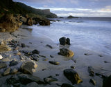 The tide retreats as the sun rises over Murlough Bay, County Antrim