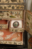 Close view of jewellery and the drawers of the C17th stumpwork box in which it is kept, part of the Charles Wade collection, in Occidens, the room which used to house the costume collection, Snowshill Manor