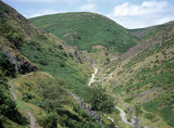 The Carding Mill Valley on the Long Mynd, where a stream meanders along in the bottom