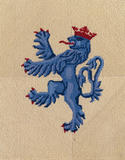 Close up view of the firescreen in the Dining room showing the Benthall arms (lion rampant double queued azure ducally crowned gules