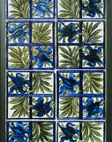 "Close view of the ""Tulip and Trellis"" ceramic tiles in the Visitors' Bathroom at Wightwick Manor"