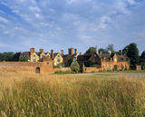 A view over a grassy field of Packwood House, Warwickshire from the east