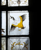 William Morris stained glass panel of a farmyard duck flying, in the Ground Floor passage at Red House
