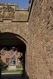 View through the outer gate towards the drum towers and the lead statue of Fame in the courtyard at Powis Castle, Powys, Wales